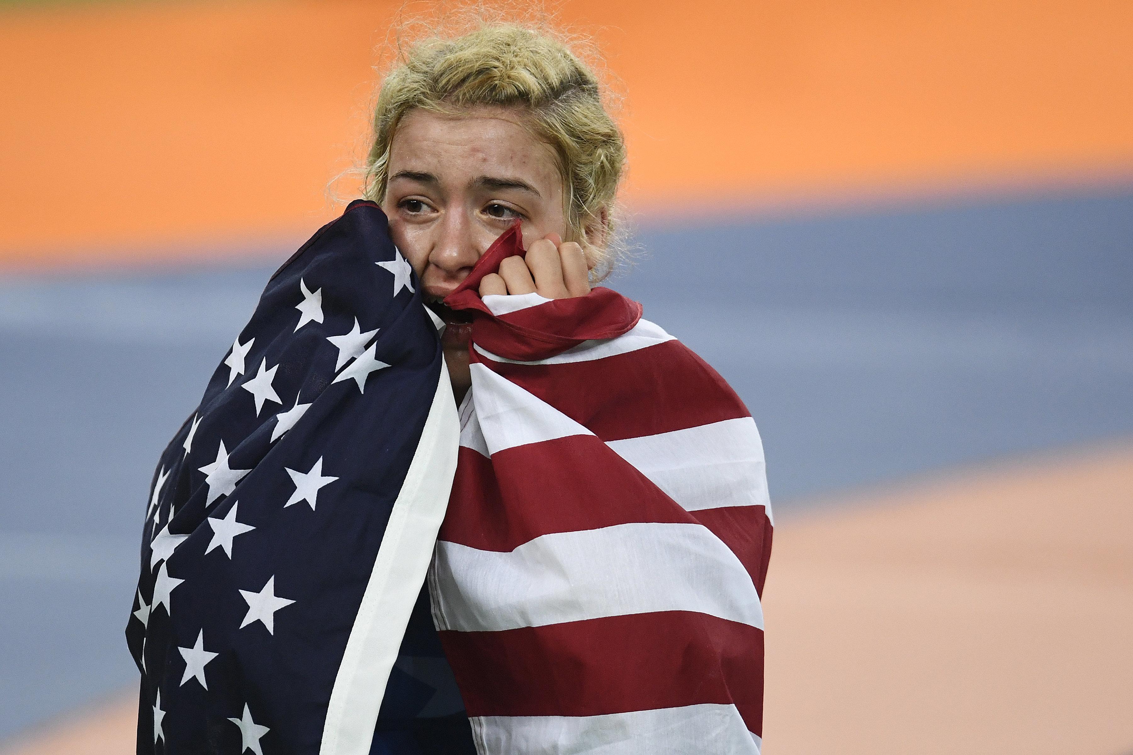 Helen Maroulis reacts to defeating Saori Yoshida of Japan during 53kg women's freestyle wrestling title match on Thursday, Au