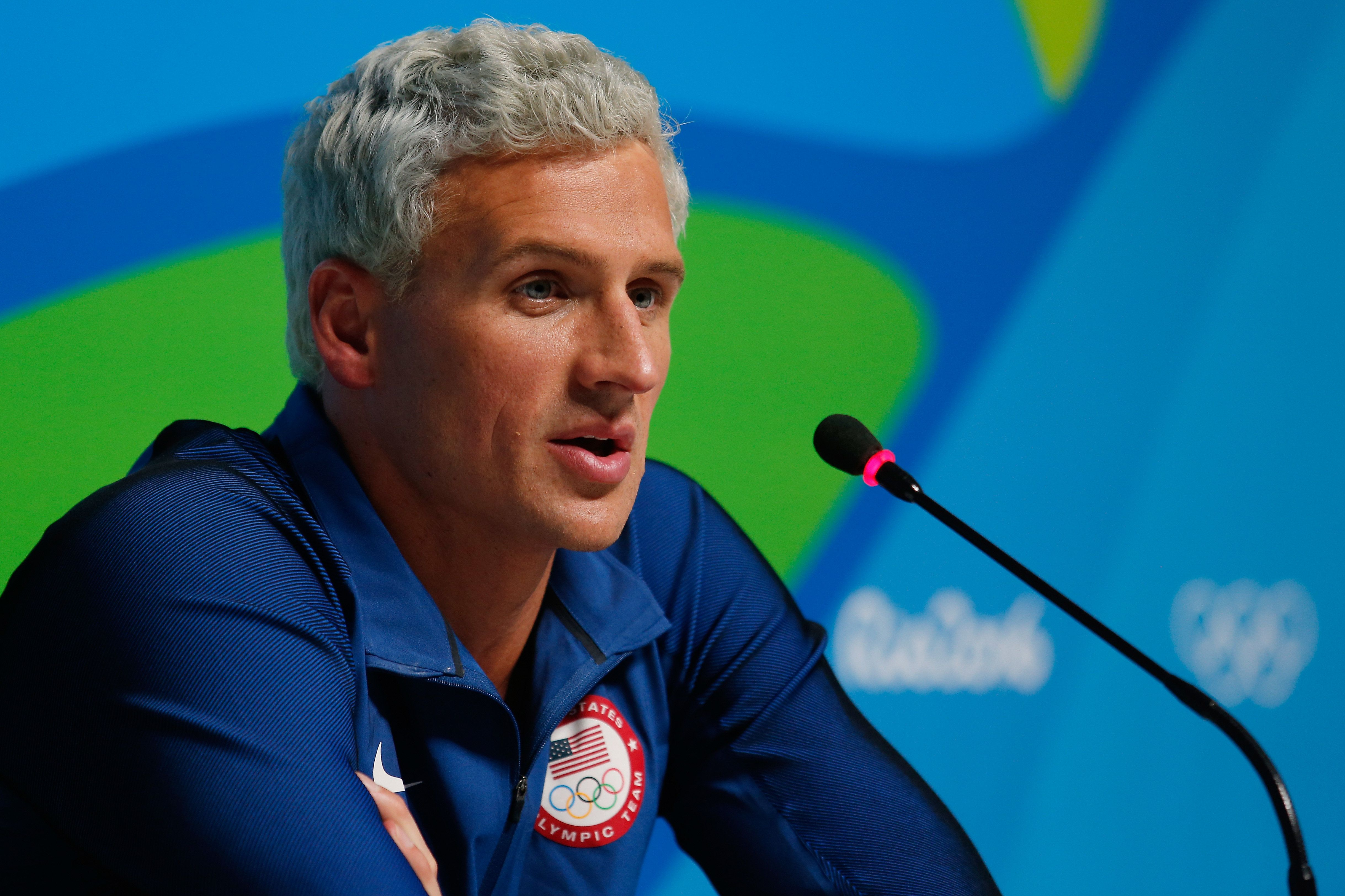 Ryan Lochte of the United States attends a press conference in the Main Press Center on Day 7 of the...