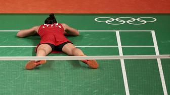 2016 Rio Olympics - Badminton - Women's Singles - Gold Medal Match - Riocentro - Pavilion 4 - Rio de Janeiro, Brazil - 19/08/2016. Carolina Marin (ESP) of Spain lies on the court as she celebrates after winning her match against P.V. Sindhu (IND) of India.       REUTERS/Alkis Konstantinidis FOR EDITORIAL USE ONLY. NOT FOR SALE FOR MARKETING OR ADVERTISING CAMPAIGNS.