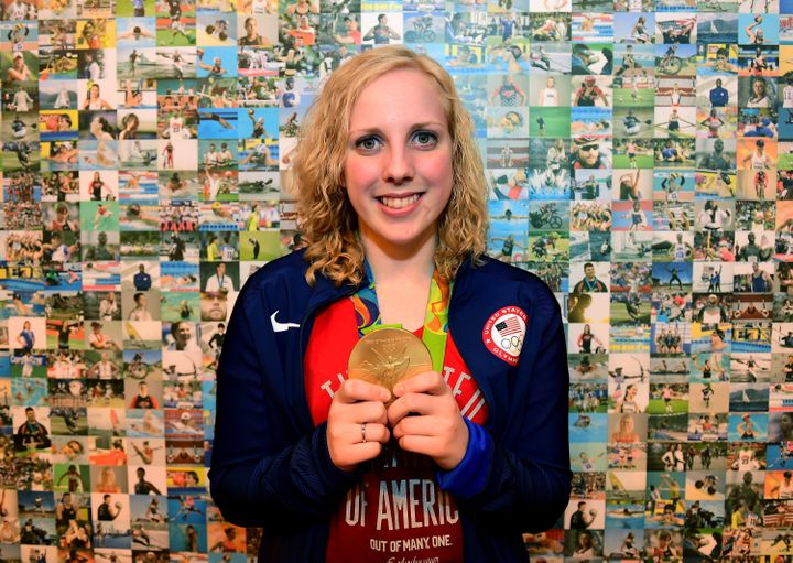 Thrasher poses with her gold medal at the USA House in Rio.