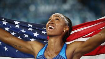 RIO DE JANEIRO, BRAZIL - AUGUST 17:  Brianna Rollins of the United States reacts after winning the gold medal in the Women's 100m Hurdles Final on Day 12 of the Rio 2016 Olympic Games at the Olympic Stadium on August 17, 2016 in Rio de Janeiro, Brazil.  (Photo by Cameron Spencer/Getty Images)