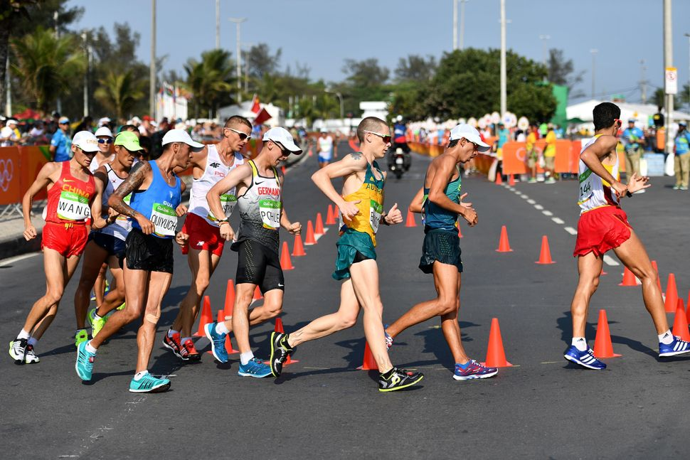 Athletes compete in the men's 50km race walk.