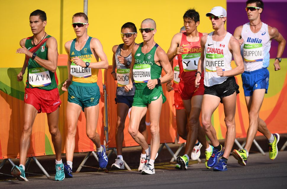 Jared Tallent of Australia, Robert Heffernan of Ireland and Evan Dunfee of Canada compete in the 50km race walk. Tallent won