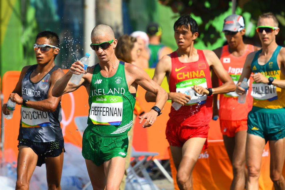 Andres Chocho of Ecuador, Robert Heffernan of Ireland, Yu Wei of China and Jared Tallent of Australia compete in the 50km rac