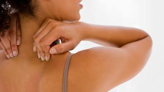 Woman rubbing her back