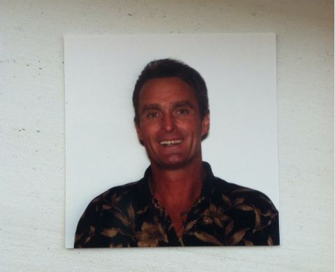Michael Paul smiles for his passport photo. His mother and brother told The Huffington Post that Mike volunteered to DJ an Au