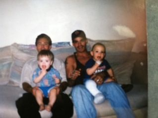 Michael Paul and his brother, John, hold their sons in their laps and enjoy each other's company. John, a Miss