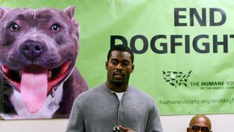 Philadelphia Eagles quarterback Michael Vick makes a stop in Durham, North Carolina, Friday, February 26, 2010, to speak to students and local residents at the New Horizons alternative school about his mistakes being involved in dog fighting and of second chances in life. He was introduced to the packed assembly room by Ralph Hawthorne, right, of the Humane Society of the United States.  (Photo by Harry Lynch/Raleigh News & Observer/MCT via Getty Images)
