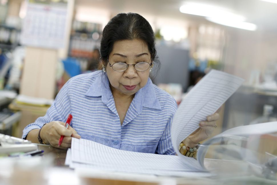 Sunisa Hongaroon, 67, is an accountant who works for a transportation company in Bangkok, Thailand. The number of people