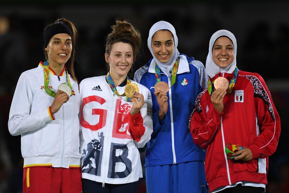 Eva Calvo Gomez of Spain, gold medalist, Jade Jones of Great Britain and bronze medalists Kimia Alizadeh Zenoorin and Hedaya