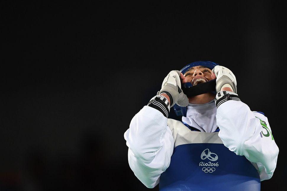 Kimia Alizadeh Zenoorin celebrates after winning against Sweden's Nikita Glasnovic in their womens taekwondo bronze medal bou