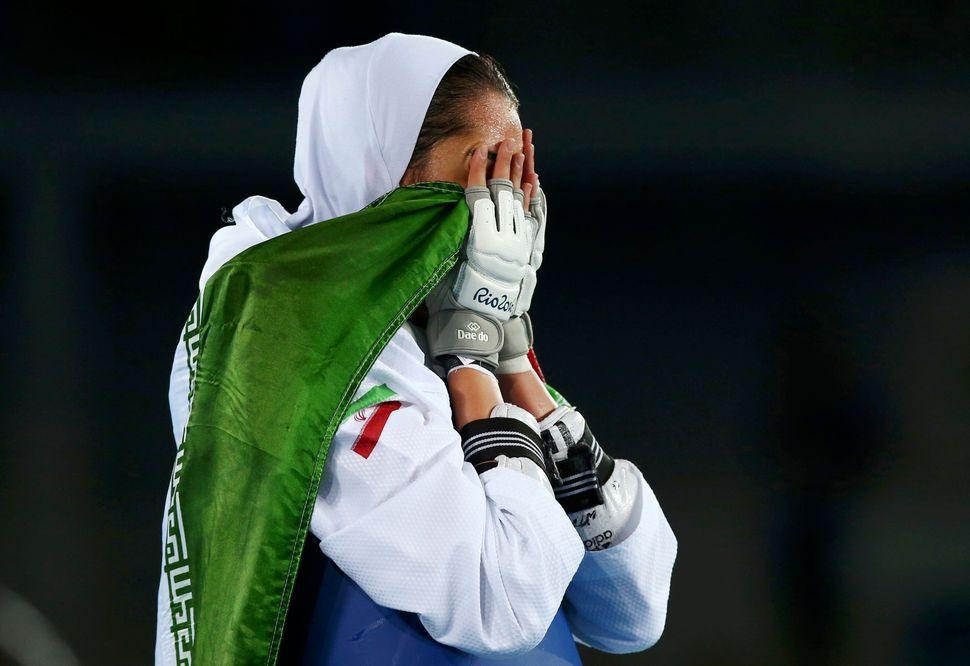 Kimia Alizadeh Zenoorin celebrates.