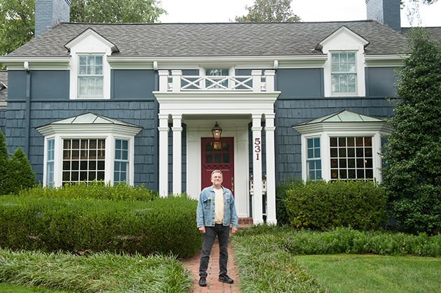 """Jonathan Wolff stands in front of Bassland while wearing a """"Seinfeld"""" jacket."""
