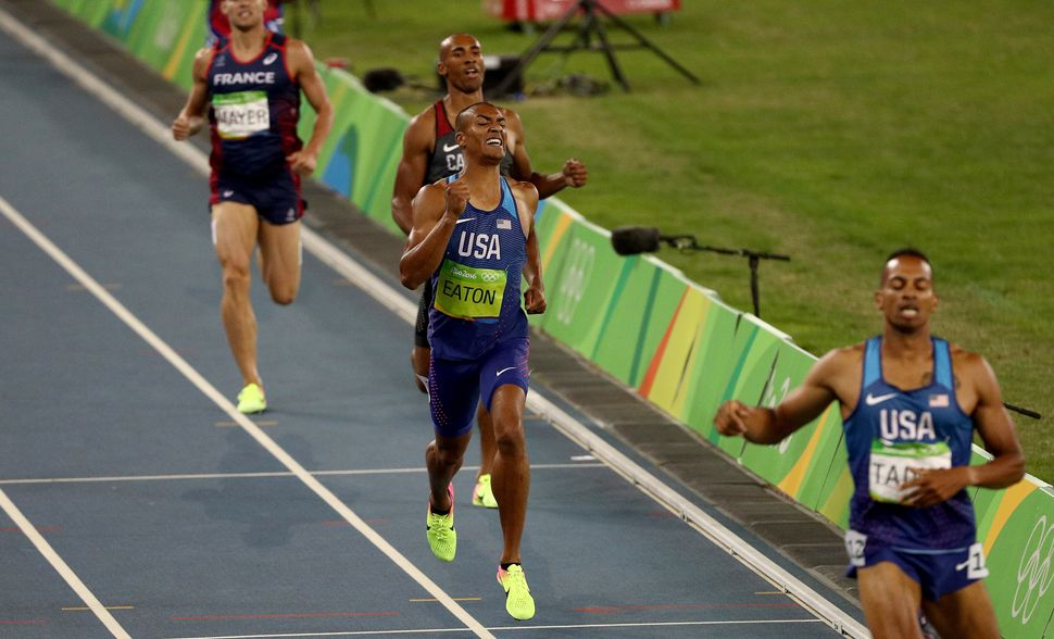 Gold medalist Ashton Eaton of the United States grinds out the last steps of the 1500m race, the final event of the