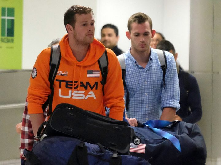 U.S. Swimmers Jack Conger and Gunnar Bentz arrive on an overnight flight from Brazil to Miami.