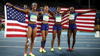 RIO DE JANEIRO, BRAZIL - AUGUST 19:  English Gardner, Allyson Felix, Tianna Bartoletta and Tori Bowie of the United States celebrate winning gold in the Women's 4 x 100m Relay Final on Day 14 of the Rio 2016 Olympic Games at the Olympic Stadium on August 19, 2016 in Rio de Janeiro, Brazil.  (Photo by Cameron Spencer/Getty Images)