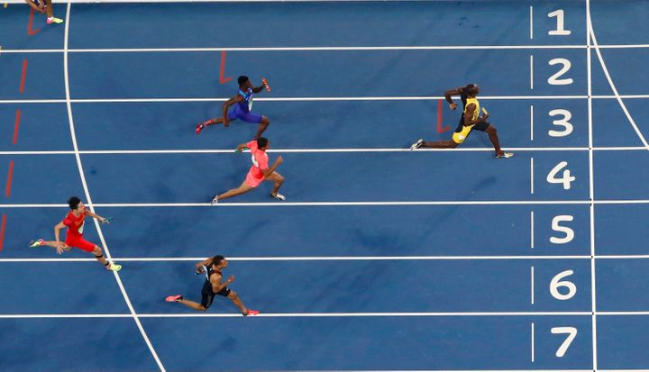 Usain Bolt races toward the finish line to win the gold.