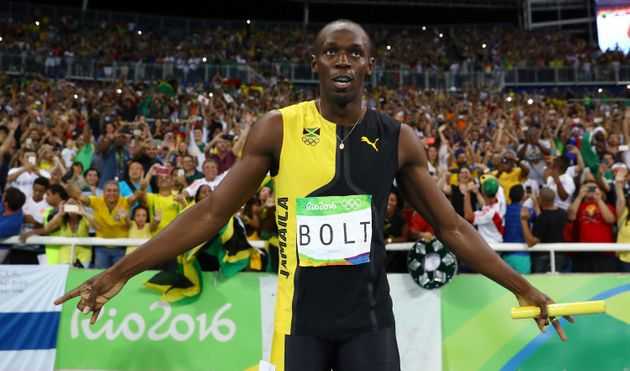 Usain Bolt celebrates after winning his third gold medal of the Rio Olympics on