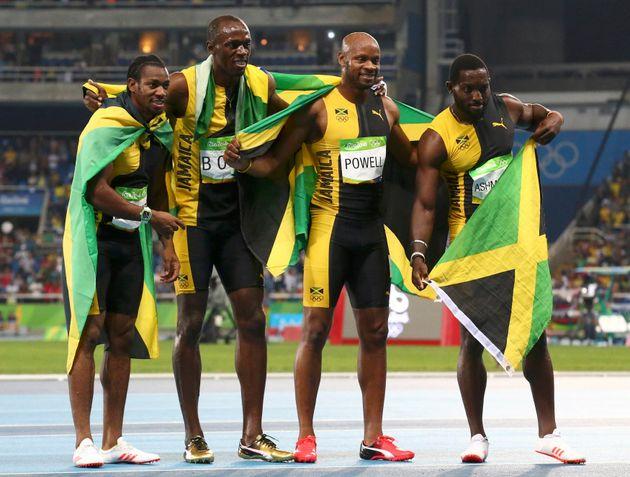 Asafa Powell, Yohan Blake, Nickel Ashmeade and Usain Bolt of Jamaica celebrate their first-place finish...