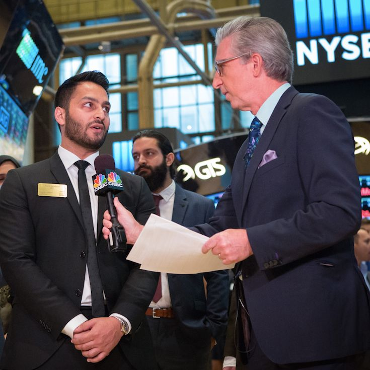 Pictured: Asad Saddique (left) being interviewed at NYSE by CNBC
