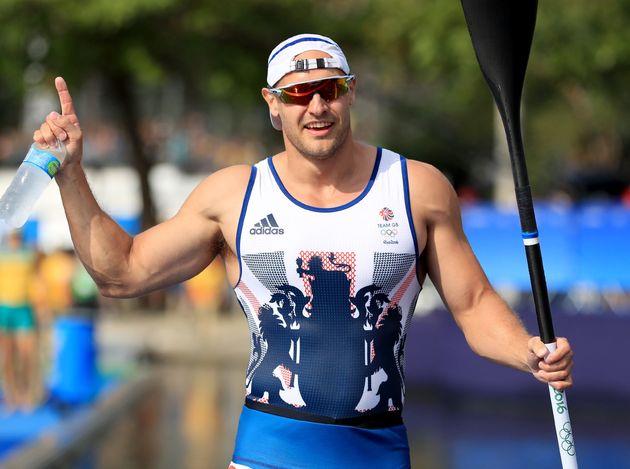 Great Britain's Liam Heath celebrates winning gold in the men's 200m kayak