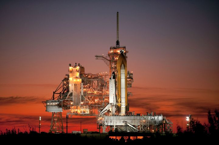 <i>Space shuttle Atlantis sits on the launch pad prior to launch in November 2009. The twilight photo was used on the cover o