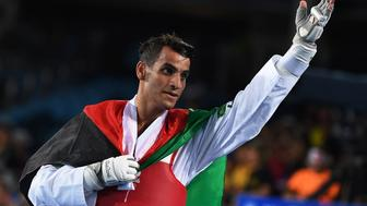 Jordan's Ahmad Abughaush celebrates after winning against Russia's Alexey Denisenko in the men's taekwondo gold medal bout in the -68kg category as part of the Rio 2016 Olympic Games, on August 18, 2016, at the Carioca Arena 3, in Rio de Janeiro. / AFP / Kirill KUDRYAVTSEV        (Photo credit should read KIRILL KUDRYAVTSEV/AFP/Getty Images)