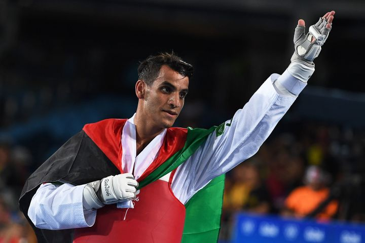 Jordan's Ahmad Abughaush celebrates after winning the men's taekwondo gold medal in the -68kg category on Aug. 18, 2016.