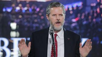 LYNCHBURG, VA - JANUARY 18:  Liberty University President Jerry Falwell, Jr. introduces Republican presidential candidate Donald Trump with a sports jersey after he delivered the convocation in the Vines Center at the university  January 18, 2016 in Lynchburg, Virginia. Although Falwell said the university does not endorse a particular candidate, he left no question as to who he is supporting in the 2016 presidential race. Highlighting Trump's conservative credentials, charity and politically incorrect speech, Falwell said, 'I see a lot of parallels between my father and Donald Trump.'  (Photo by Chip Somodevilla/Getty Images)