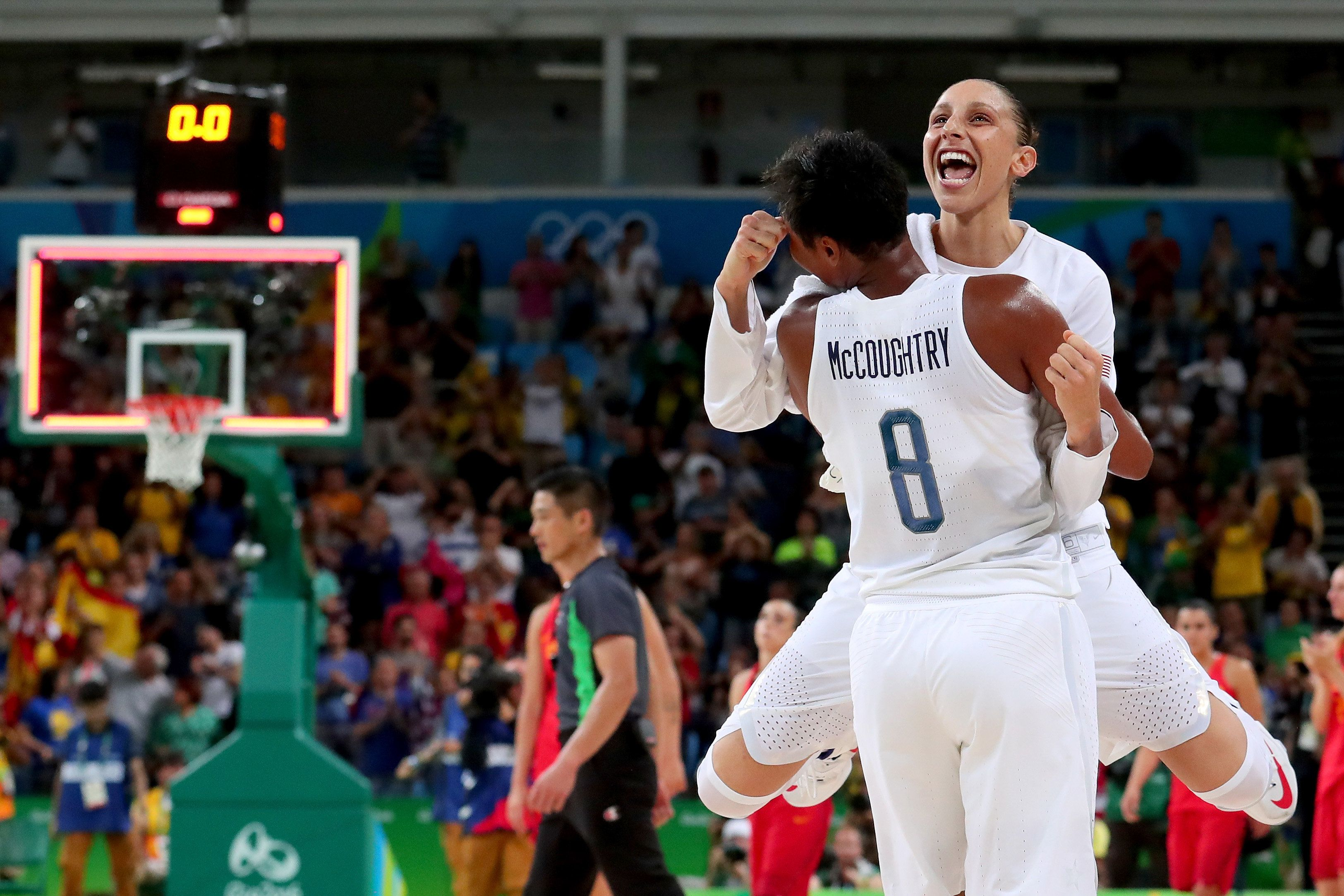 Angel Mccoughtry and Diana Taurasi celebrate after winning the Women's Gold Medal Game in Rio de Janeiro, Brazil.