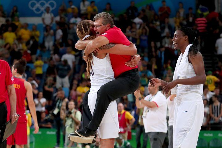 Brittney Griner hugs Geno Auriemma after winning the Women's Gold Medal Game in Rio de Janeiro, Brazil.