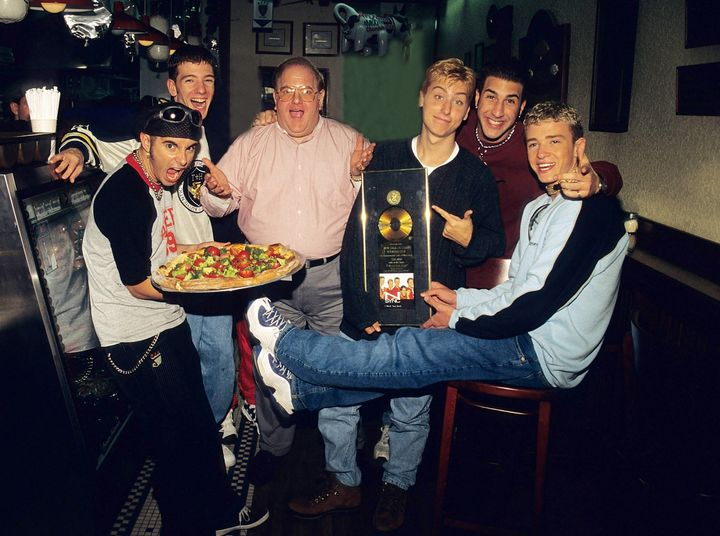 Lou Pearlman poses with *NSYNC: Chris Kirkpatrick, JC Chasez, Lance Bass, Joey Fatone and Justin Timberlake at N.Y.P.D.