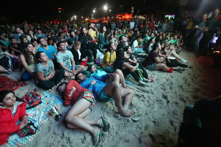 Brazilians watch a live broadcast of the Olympic men's soccer final on Leblon beach in Rio de Janeiro, Aug. 20, 2016.