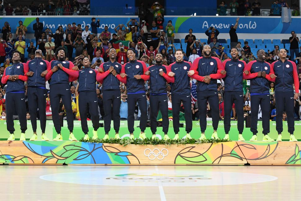 The U.S. men's basketball team locks arms after winning the gold medal.