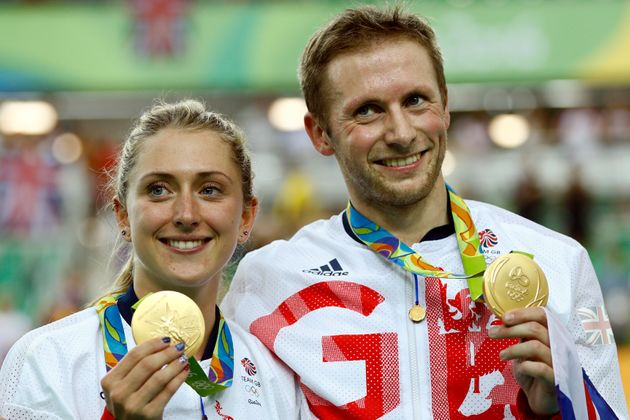 Laura Trott and Jason Kenny pose with their gold medals at the Rio Olympic