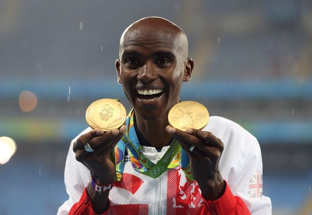 Mo Farah with his gold medals for victory in the 5,000m and