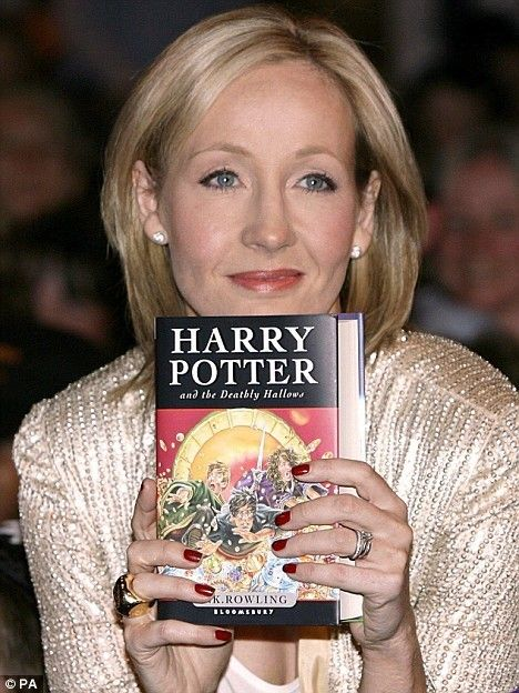 JK Rowling with a copy of her Harry Potter Series