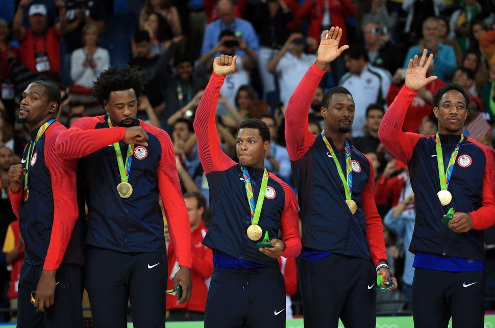Kevin Durant #5, DeAndre Jordan #6, Kyle Lowry #7, Harrison Barnes #8 and DeMar DeRozan #9 of the USA celebrate after winning