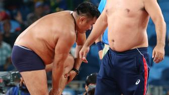 RIO DE JANEIRO, BRAZIL - AUGUST 21, 2016: Mongolian Mandakhnaran Ganzorig's coaches take off their clothes in protest after losing the men's -65kg freestyle wrestling bronze medal bout against Uzbekistan's Ikhtiyor Navruzov at the Rio 2016 Summer Olympic Games, at Carioca Arena 2. Stanislav Krasilnikov/TASS (Photo by Stanislav Krasilnikov\TASS via Getty Images)