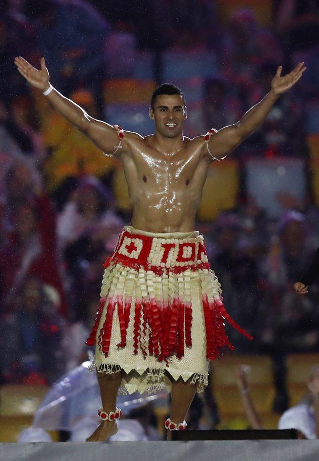 Pita Taufatofua of Tonga jumps on stage during the closing