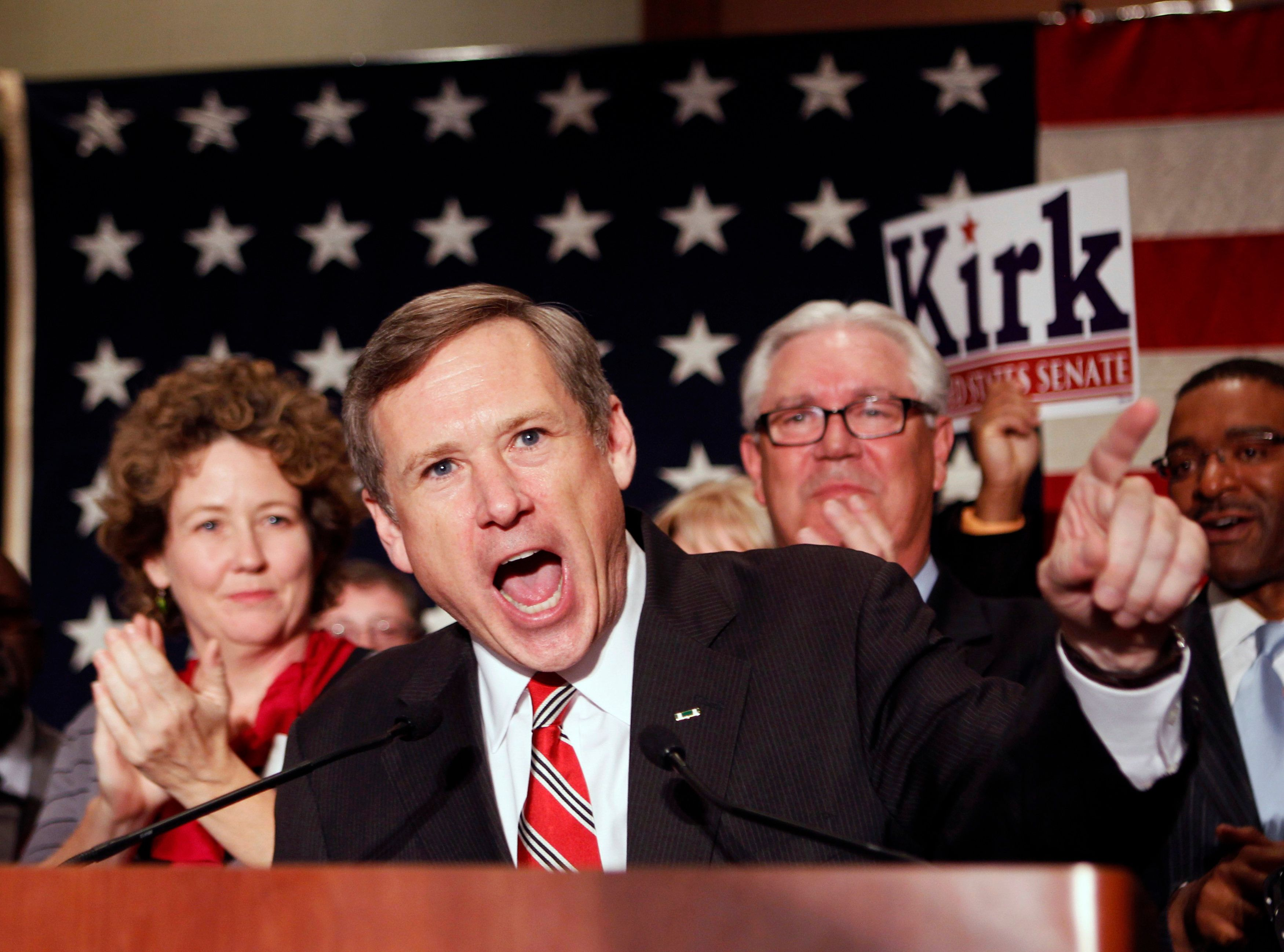 Republican U.S. Senate candidate Mark Kirk of Illinois celebrates with his family and supporters after beating Democratic nominee Alexi Giannoulias for the Senate seat formally held by U.S. President Barack Obama, at an election night rally in Wheeling, Illinois November 2, 2010. REUTERS/Jeff Haynes (UNITED STATES - Tags: ELECTIONS POLITICS)