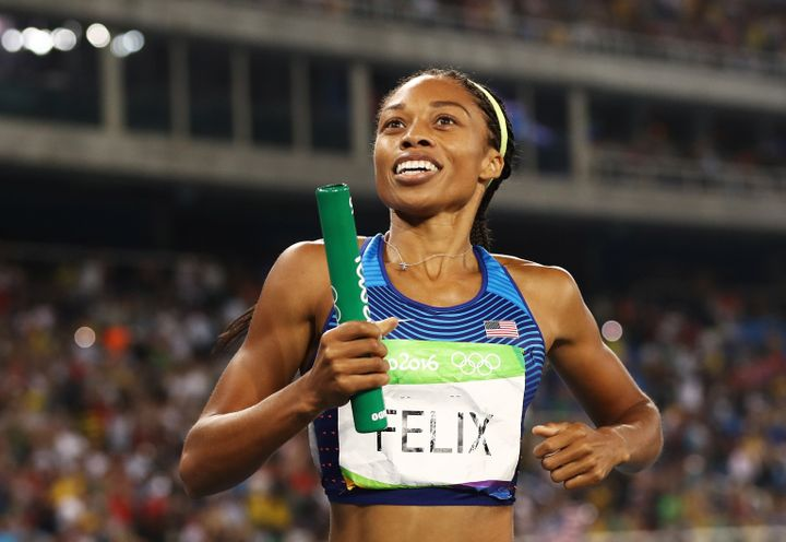 Allyson Felix reacts after winning gold during the Women's 4 x 400 meter Relay