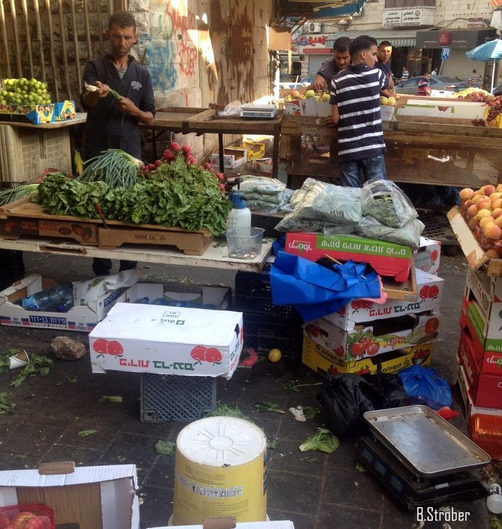 In the market in Ramallah, filled with fruit boxes from Israel.