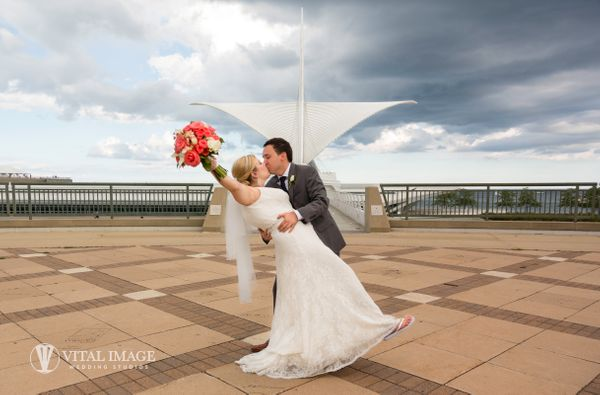 """""""Morning rain showers did not dampen their wonderful celebration in the afternoon. Emily and Ryan were married in a beautiful"""