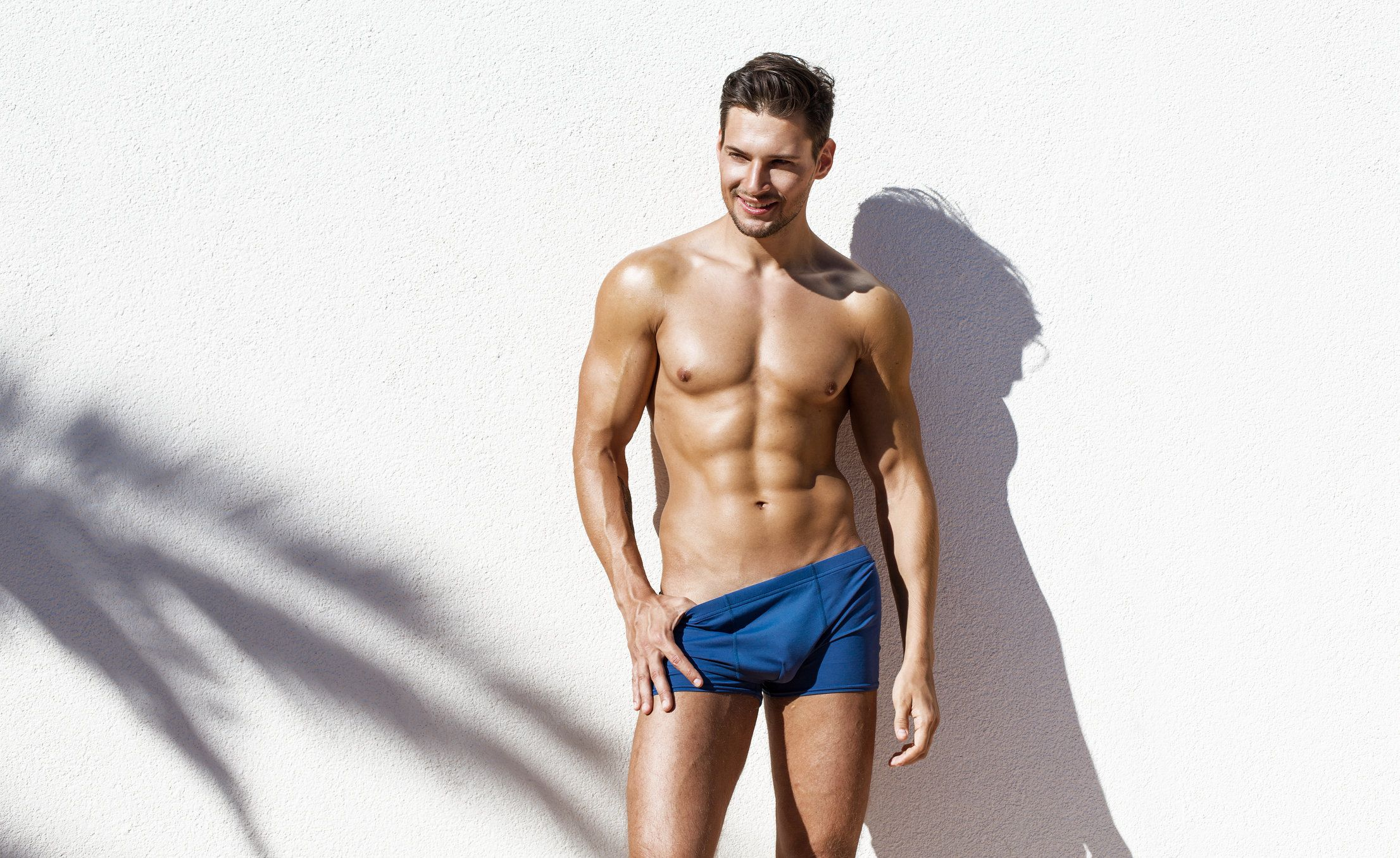Handsome atletic man wearing swimming trunks