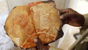 A salvaged manuscript at the Ahmed Baba Centre for Documentation and Research in Timbuktu. Thousands of ancient manuscript were destroyed when Islamists took over the city in 2012.