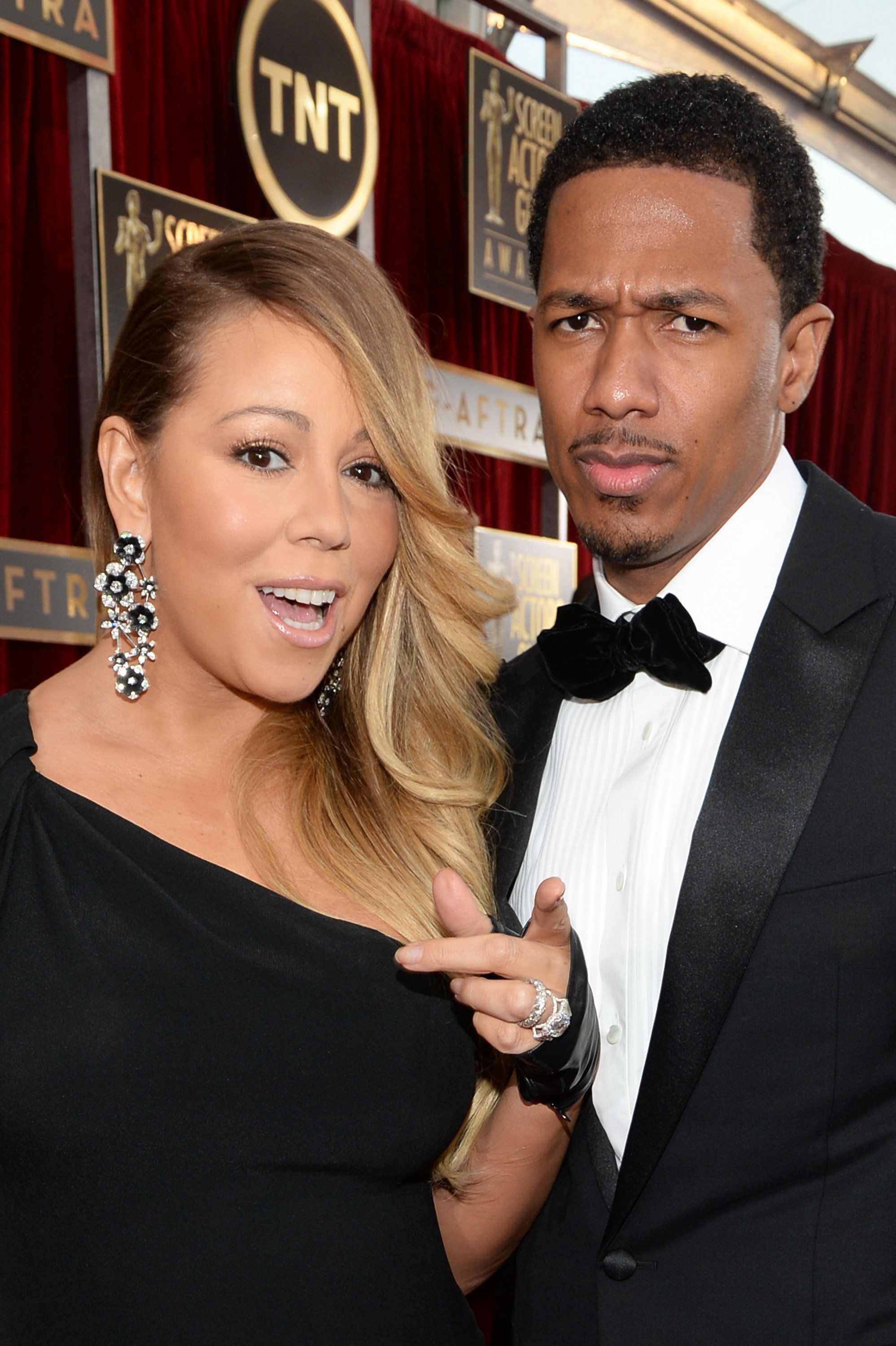 LOS ANGELES, CA - JANUARY 18:  Singer Mariah Carey (L) and TV personality Nick Cannon attend 20th Annual Screen Actors Guild Awards at The Shrine Auditorium on January 18, 2014 in Los Angeles, California.  (Photo by Dimitrios Kambouris/WireImage)
