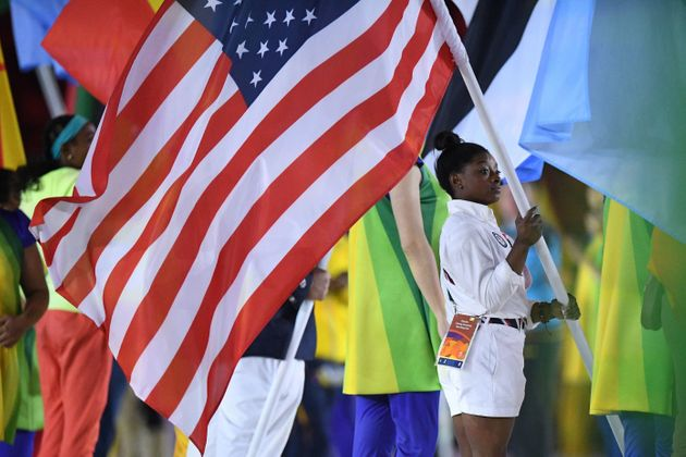 Simone Biles was given the honor of carrying the U.S. flag during the Closing