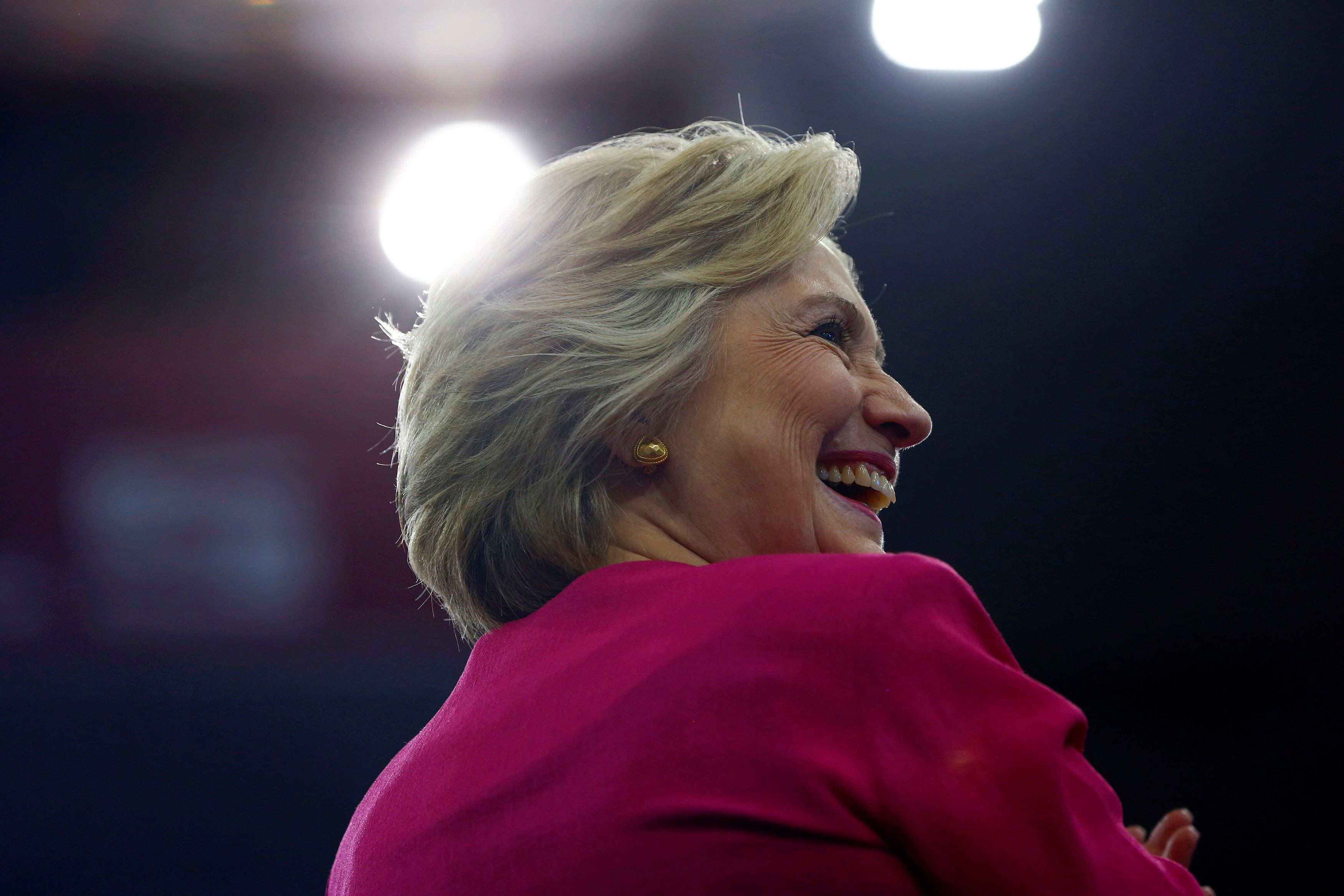 """""""I see you making the drive to a clinic 200 miles away,"""" Clinton writes in a recent essay. """"I see you dropping your daughter"""