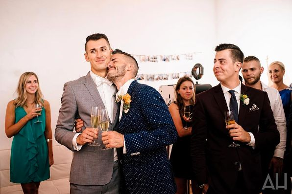 """""""Lucio and Joey share a moment during the toasts at their beautiful rooftop wedding in SoHo."""" --<i>Andrew Henderson</i>"""